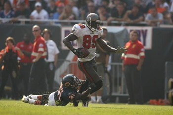CHICAGO - SEPTEMBER 21:  Antonio Bryant #89 of the Tampa Bay Buccaneers runs with the ball against Nathan Vasher #31 of the Chicago Bears at Soldier Field on September 21, 2008 in Chicago, Illinois. The Buccaneers won 27-24 in OT. (Photo by Jonathan Ferre