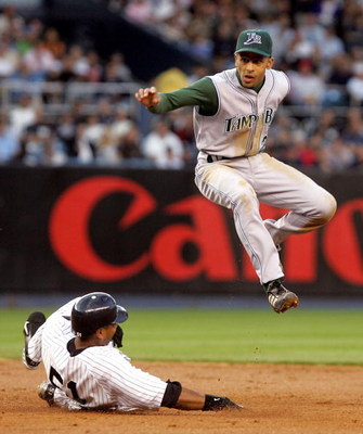 BRONX, NY - JUNE 20:  Julio Lugo #23 of the Tampa Bay Devil Rays jumps out of the way after forcing out Bernie Williams #51 of the New York Yankees at second base on June 20, 2005 at Yankee Stadium in the Bronx borough of New York City.  (Photo by Jim McI