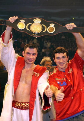 DORTMUND - NOVEMBER 23:   Vitali Klitschko (L) with his brother Vladimir after Vitali defeated Larry Donald of USA during the WBA Heavyweight title fight at The Westfalenhalle, Dortmund, Germany on November 23, 2002. (Photo by Stuart Franklin/Getty Images