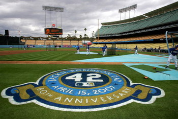 LOS ANGELES, CA - APRIL 15:  The Los Angeles Dodgers take batting practice in front of an on the field logo in honor of Jackie Robinson before the game with the San Diego Padres on April 15, 2007 at Dodger Stadiium in Los Angeles, California.  (Photo by S