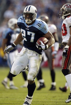NASHVILLE, TN - DECEMBER 28:  Running back Eddie George #27 of the Tennessee Titans runs the football during the game against the Tampa Bay Buccaneers on December 28, 2003 at The Coliseum in Nashville, Tennessee. The Titans defeated the Buccaneers 33-13.