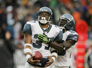 CHICAGO - JANUARY 14:  Running back Shaun Alexander #37 and wide receiver Deion Branch #83 of the Seattle Seahawks celebrate a play against the Chicago Bears during their NFC Divisional Playoff game on January 14, 2007 at Soldier Field in Chicago, Illinoi