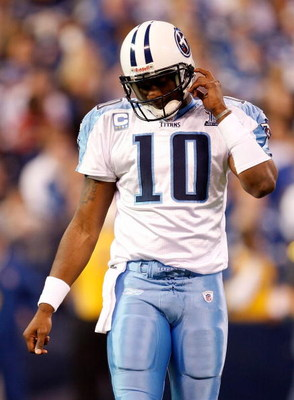 INDIANAPOLIS - DECEMBER 28:  Quarterback Vince Young #10 of the Tennessee Titans walks off the field during the game against the Indianapolis Colts at Lucas Oil Stadium December 28, 2008 in Indianapolis, Indiana.  (Photo by Jamie Squire/Getty Images)