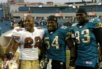 San Francisco 49ers  fullback Terry Jackson (22) greets Jacksonville Jaguars Mike Peterson (54) and defensive  end Bobby McCray (93)  December 18, 2005 in Jacksonville.   The three players are University of Florida graduates.   The Jaguars defeated the 49