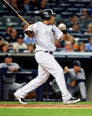 NEW YORK - JUNE 30: Melky Cabrera #53 of the New York Yankees hits a sacrifice fly against the Seattle Mariners June 30, 2009 at Yankee Stadium in the Bronx borough of New York City.  (Photo by Mario Tama/Getty Images)