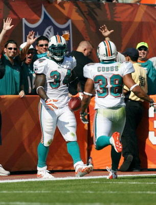 MIAMI - NOVEMBER 09:  Running back Ricky Williams #34 and Patrick Cobbs #38 of the Miami Dolphins celebrate a 51 yard touchdown run by Williams while facing the Seattle Seahawks at Dolphin Stadium on November 9, 2008 in Miami, Florida. The Dolphins defeat