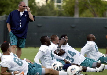 DAVIE, FL - JUNE 06:  Head coach Tony Sparano (L) watches running back Ricky Williams #34 stretch during Miami Dolphins Mini Camp on June 6, 2008 at the Dolphins practice facility in Davie, Florida.  (Photo by Marc Serota/Getty Images)