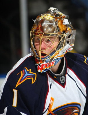 UNIONDALE, NY - DECEMBER 23:  Johan Hedberg #1 of the Atlanta Thrashers tends the net against the New York Islanders on December 23, 2009 at the Nassau Coliseum in Uniondale, New York.  (Photo by Bruce Bennett/Getty Images)