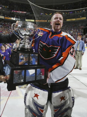 PHILADELPHIA - JUNE 10: Neil Little #31 of the Philadelphia Phantoms celebrates with the Calder Cup after the Phantoms defeated the Chicago Wolves 5-2 to sweep the series at the Wachovia Center on June 10, 2005 in Philadelphia, Pennsylvania. (Photo by Bru