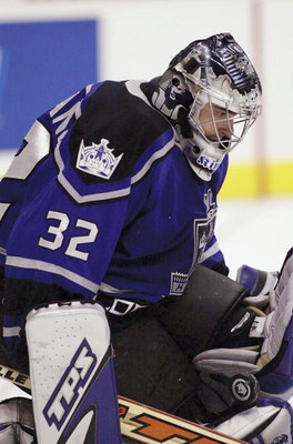 LOS ANGELES - NOVEMBER 13:  Goaltender Roman Cechmanek #32 of the Los Angeles Kings gets a pad on a shot by the Toronto Maple Leafs on November 13, 2003 at Staples Center in Los Angeles, California.  (Photo by Victor Decolongon/Getty Images)