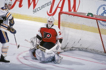 BUFFALO, NY - 1990:  Goalie Pete Peeters #33 of the Philadelphia Flyers keeys his eyes on the action as he protects the net during a game against the Buffalo Sabres in the 1990-1991 NHL season at Buffalo Memorial Auditorium in Buffalo, New York.  (Photo b