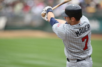 OAKLAND, CA - JUNE 11:  Joe Mauer #7 of the Minnesota Twins bats against the Oakland Athletics during a Major League Baseball game on June 11, 2009 at the Oakland Coliseum in Oakland, California.  (Photo by Jed Jacobsohn/Getty Images)