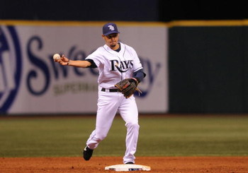 ST. PETERSBURG, FL - APRIL 13: Shortstop Jason Bartlett #8 of the of the the Tampa Bay Rays throws to first base against the New York Yankees April 13, 2009 in St. Petersburg, Florida.  (Photo by Al Messerschmidt/Getty Images)
