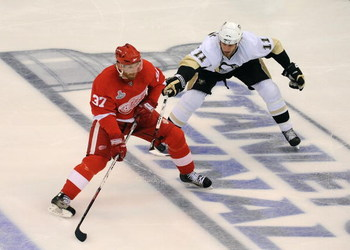DETROIT - JUNE 12:  Mikael Samuelsson #37 of the Detroit Red Wings controls the puck near the blueline against Jordan Staal #11 of the Pittsburgh Penguins during Game Seven of the 2009 NHL Stanley Cup Finals at Joe Louis Arena on June 12, 2009 in Detroit,