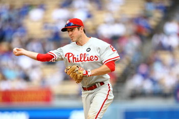 LOS ANGELES, CA - JUNE 06:  Chase Utley #26 of the Philadelphia Phillies fields against the Los Angeles Dodgers at Dodger Stadium on June 6, 2009 in Los Angeles, California. The Dodgers defeated the Phillies 3-2 in 12 innings.  (Photo by Jeff Gross/Getty