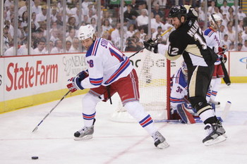 PITTSBURGH - APRIL 25: Marc Staal #18 of the New York Rangers holds off Ryan Malone #12 of the Pittsburgh Penguins as Staal attempts to control the puck during game one of the Eastern Conference Semifinals of the 2008 NHL Stanley Cup Playoffs on April 25,