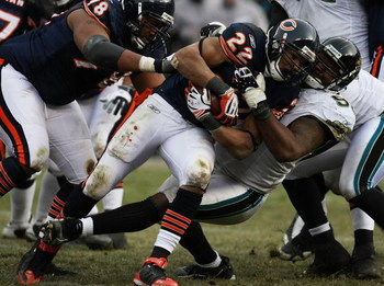 CHICAGO - DECEMBER 07: Matt Forte #22 of the Chicago Bears is tackled by Paul Spicer #95 of the Jacksonville Jaguars on December 7, 2008 at Soldier Field in Chicago, Illinois. The Bears defeated the Jaguars 23-10. (Photo by Jonathan Daniel/Getty Images)