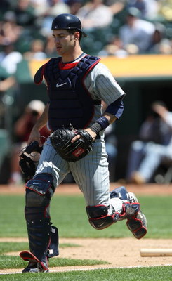 OAKLAND, CA - JUNE 11:  Joe Mauer #7 of the Minnesota Twins catches against the Oakland Athletics during a Major League Baseball game on June 11, 2009 at the Oakland Coliseum in Oakland, California.  (Photo by Jed Jacobsohn/Getty Images)
