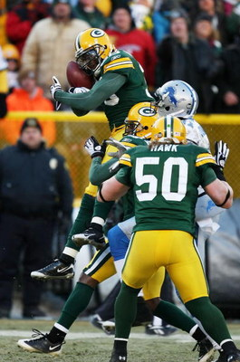 GREEN BAY, WI - DECEMBER 28: Nick Collins #36 of the Green Bay Packers leaps to intercept a pass against the Detroit Lions on December 28, 2008 at Lambeau Field in Green Bay, Wisconsin. The Packers defeated the Lions 31-21. (Photo by Jonathan Daniel/Getty