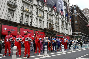 NEW YORK - MAY 18:  Dario Franchitti (L) driver of the #10 Target Chip Ganassi Racing Dallara Honda, Ryan Briscoe (C) driver of the #6 Team Penske Dallara Honda and Helio Castroneves, (R) driver of the #3 Team Penske Dallara Honda stand in the front row a