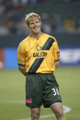 CARSON, CA - JUNE 18:  Defender Alexi Lalas #30 of the Los Angeles Galaxy smiles during player introductions before the Major League Soccer (MLS) game against the San Jose Earthquakes at the Home Depot Center on June 18, 2003 in Carson, California.  The g