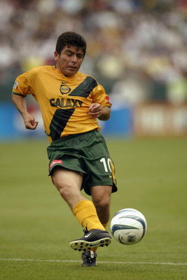 CARSON, CA - JUNE 7:  Midfielder Mauricio Cienfuegos #10 of the Los Angeles Galaxy passes the ball against the Colorado Rapids during the inaugural match at the state-of-the-art Home Depot Center on June 7, 2003 in Carson, California.  The Galaxy defeated