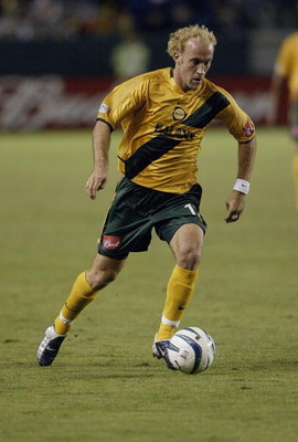 CARSON, CA - NOVEMBER 1:   Simon Elliott #12 of the Los Angeles Galaxy dribbles against the San Jose Earthquakes during the first round of the MLS Playoffs on November 1, 2003 in Torrance, California.  The Galaxy defeated the Earthquakes 2-0.  (Photo by D