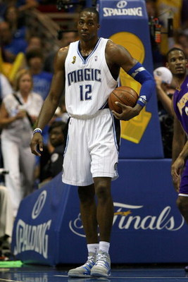 ORLANDO, FL - JUNE 14:  Dwight Howard #12 of the Orlando Magic holds the ball under the basket in the second half against the Los Angeles Lakers in Game Five of the 2009 NBA Finals on June 14, 2009 at Amway Arena in Orlando, Florida.  NOTE TO USER:  User
