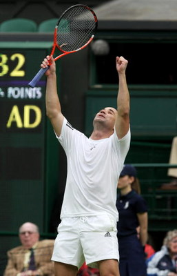LONDON, ENGLAND - MAY 17:  Andre Agassi celebrates during the Mens Singles match againstTim Henman during the 'Centre Court Celebration' at Wimbledon on May 17, 2009 in London, England.  (Photo by Hamish Blair/Getty Images)
