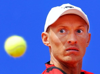 BARCELONA, SPAIN - APRIL 25:  Nikolay Davydenko of Russia eyes the ball during his semi-final match against Rafael Nadal of Spain on day six of the ATP 500 World Tour Barcelona Open Banco Sabadell 2009 tennis tournament at the Real Club de Tenis on April