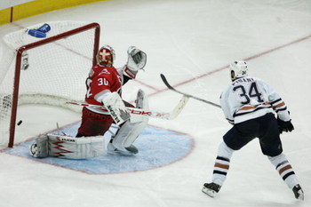 RALEIGH, NC - JUNE 14:  Fernando Pisani #34 of the Edmonton Oilers scores a short handed game winning goal past goaltender Cam Ward #30 of the Carolina Hurricanes in game five of the 2006 NHL Stanley Cup Finals on June 14, 2006 at the RBC Center in Raleig