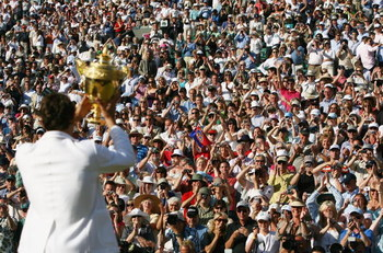 LONDON - JULY 08:  Roger Federer of Switzerland lifts the trophy as he celebrates victory following the Men's Singles final match against Rafael Nadal of Spain during day thirteen of the Wimbledon Lawn Tennis Championships at the All England Lawn Tennis a