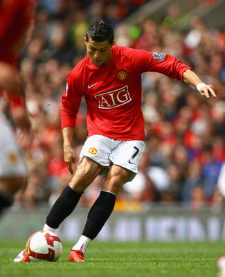 MANCHESTER, ENGLAND - MAY 10:  Cristiano Ronaldo of Manchester United scores the opening goal during the Barclays Premier League match between Manchester United and Manchester City at Old Trafford on May 10, 2009 in Manchester, England.  (Photo by Alex Li