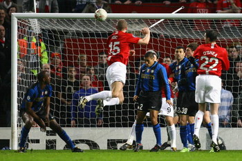 MANCHESTER, UNITED KINGDOM - MARCH 11:  Nemanja Vidic of Manchester United scores the opening goal during the UEFA Champions League Round of Sixteen, Second Leg match between Manchester United and Inter Milan at Old Trafford on March 11, 2009 in Mancheste