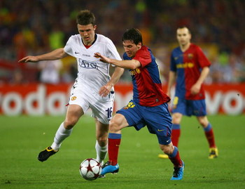 ROME - MAY 27:  Lionel Messi of Barcelona battles for the ball with Michael Carrick of Manchester United during the UEFA Champions League Final match between Barcelona and Manchester United at the Stadio Olimpico on May 27, 2009 in Rome, Italy.  (Photo by