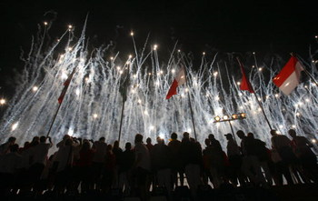 PESCARA, ITALY - JUNE 26:  A fireworks display during the 2009 Mediterranean Games opening ceremony at the Adriatico Stadium on June 26, 2009 in Pescara, Italy.  (Photo by Vittorio Zunino Celotto/Getty Images)