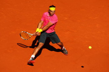 PARIS - MAY 29:  Rafael Nadal of Spain hits a backhand during his Men's Singles Third Round match against Lleyton Hewitt of Australia on day six of the French Open at Roland Garros on May 29, 2009 in Paris, France.  (Photo by Clive Brunskill/Getty Images)