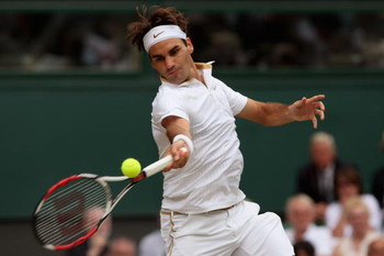 WIMBLEDON, ENGLAND - JULY 03:  Roger Federer of Switzerland plays a forehand during the men's singles semi final match against Tommy Haas of Germany on Day Eleven of the Wimbledon Lawn Tennis Championships at the All England Lawn Tennis and Croquet Club o