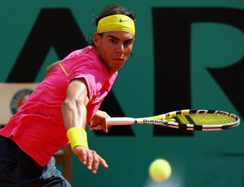 PARIS - MAY 31:  Rafael Nadal of Spain hits a forehand during the Men's Singles Fourth Round match against Robin Soderling of Sweden on day eight of the French Open at Roland Garros on May 31, 2009 in Paris, France.  (Photo by Clive Brunskill/Getty Images