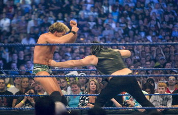 HOUSTON, TX - APRIL 5: (L-R) WWE Superstar Chris Jericho gets a punch to the gut by actor Mickey Rourke as they duel during WrestleMania 25 at Reliant Stadium on April 5, 2009 in Houston, Texas.  (Photo by Bill Olive/Getty Images)