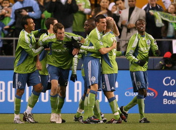 SEATTLE - MARCH 28:  Nate Jaqua #21 of the Seattle Sounders FC celebrates with the team after scoring a goal in the first half during the match against Real Salt Lake on March 28, 2009 at Qwest Field in Seattle, Washington. (Photo by Otto Greule Jr/Getty