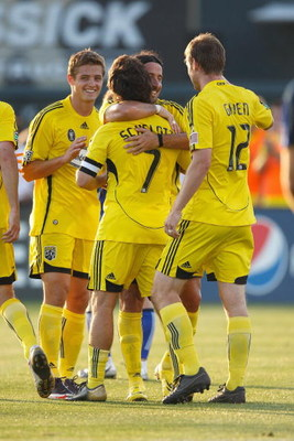 KANSAS CITY - JUNE 6:  Robbie Rogers #19, Gino Padula #4 , Guillermo Barros Schelotto #7 and Eddie Gaven #12 of the Columbus Crew celebrate against the Kansas City Wizards at CommunityAmerica Ballpark on June 6, 2009 in Kansas City, Kansas. (Photo by: Jam