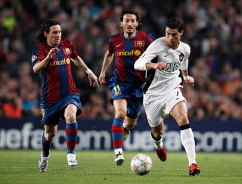 BARCELONA, SPAIN - APRIL 23:  Cristiano Ronaldo (R) of Manchester United holds off the challenge of Gianluca Zambrotta (C) and Lionel Messi (L) of Barcelona during the UEFA Champions League Semi-Final, first leg match between Barcelona and Manchester Unit