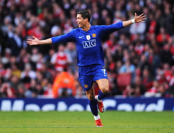 LONDON, ENGLAND - MAY 05:  Cristiano Ronaldo of Manchester United celebrates scoring the second goal of the game during the UEFA Champions League Semi Final Second Leg match between Arsenal and Manchester United at Emirates Stadium on May 5, 2009 in Londo