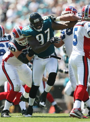 JACKSONVILLE, FL - SEPTEMBER 14:  Defensive end Reggie Hayward #97 of the Jacksonville Jaguars tries to get to get to quarterback Trent Edwards #5 of the Buffalo Bills at Jacksonville Municipal Stadium on September 14, 2008 in Jacksonville, Florida. The B