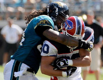 JACKSONVILLE, FL - SEPTEMBER 14:  Derek Schouman #80 of the Buffalo Bills is tackled by Mike Peterson #54 of the Jacksonville Jaguars at Jacksonville Municipal Stadium on September 14, 2008 in Jacksonville, Florida.  (Photo by Sam Greenwood/Getty Images)