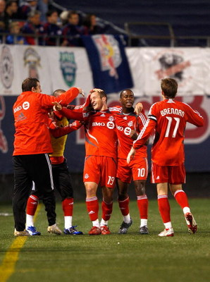 EAST RUTHERFORD, NJ - OCTOBER 04: Chad Barrett #19 of the Toronto FC celebrates with teammates after scoring a goal in the first half against the New York Red Bulls during their game at Giants Stadium on October 4, 2008 in East Rutherford, New Jersey.  (P