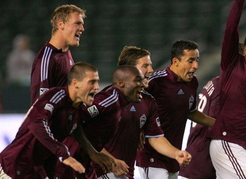 CARSON, CA - APRIL 07:  (L-R) Ty Harden #5, Colin Clark #23, Omar Cummings #14, Jordan Harvey #2 and Ivan Guerrero #12 of the Colorado Rapids react after defeating the Los Angeles Galaxy 4-2 on penalty kicks in their U.S. Open Cup match at The Home Depot