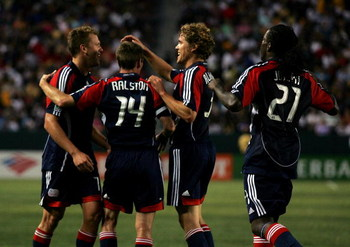 CARSON, CA - JULY 04:  Adam Cristman #7, Steve Ralston #14, Chris Albright #3 and Shalrie Joseph #21 of the New England Revolution celebrate Cristman's second of two goals in the first half against the Los Angeles Galaxy during their MLS match at the Home