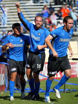 SAN JOSE, CA - OCTOBER 24:  Defender Craig Waibel #16 of the San Jose Earthquakes celebrates with teammates Brian Ching #25 (L) and Ian Russell #7 (R) after scoring against the Kansas City Wizards in game one of the MLS Western Conference semifinals on Oc
